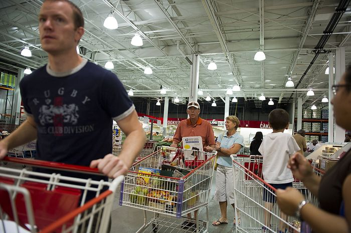 People shop at discount warehouse club Costco in Arlington, Va., on Aug. 26, 2011, a day before Hurricane Irene was expected to hit the D.C. region. (Rod