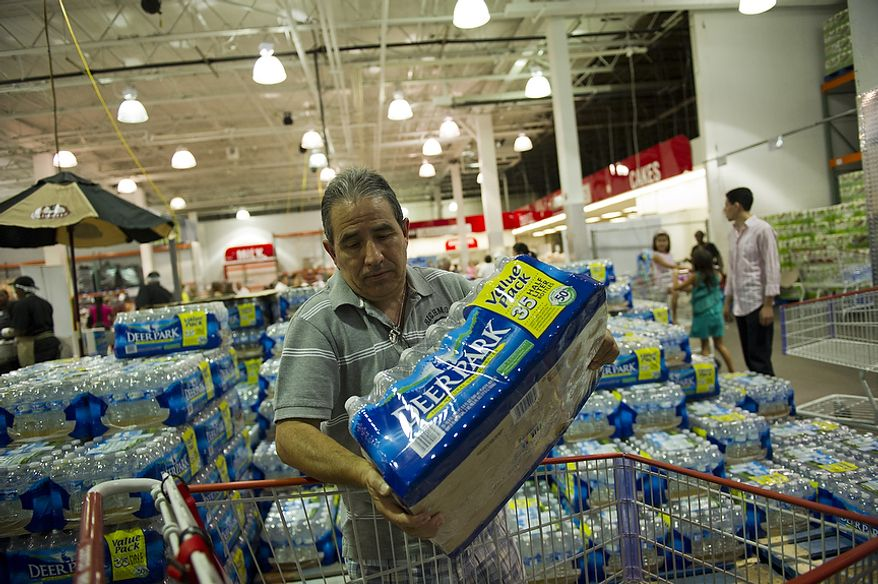 Victor Korner loads his cart with bottled water on Aug. 26, 2011, at discount warehouse club Costco in Arlington, Va., a day before Hurricane Irene was expected to hit the D.C. region. (Rod Lamkey Jr./The Washington Times)