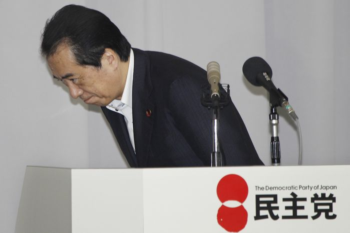 Japanese Prime Minister Naoto Kan bows after giving a speech at the Democratic Party of Japan lawmakers' meeting in Tokyo, Friday, Aug. 26, 2011. Kan announced he was resigning after almost 15 months in office amid plunging approval ratings over his government's handling of the tsunami disaster and nuclear crisis. (AP Photo/Koji Sasahara)