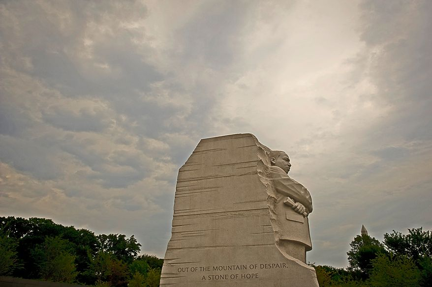 As Hurricane Irene approaches the U.S. east coast, storm clouds hang in the sky above following a downpour of rain, the newly built Martin Luther KIng Jr. National Memorial stands tall against a darkening sky in Washington, D.C., Thursday, August 25, 2011. (Rod Lamkey Jr./The Washington Times)