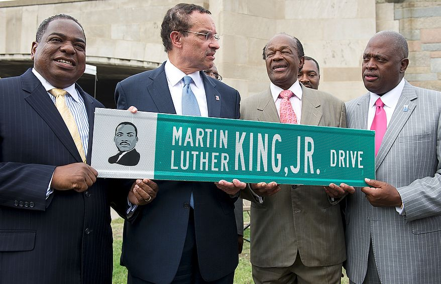 From left, Councilman Vincent Orange, D.C. Mayor Vincent Gray, Councilman Marion Barry and Harry Thompson hold one of the new Martin Luther King Jr. Drive signs at the corner of Maine Avenue and 14th Street Southwest in Washington, D.C. on Thursday, Aug. 25, 2011. The men were on sight to officially unveil the street signs that will rename this part of Maine Avenue as Martin Luther King Jr. Drive The road will continue along the Southwest Freeway and join up with the other part of Martin Luther King Jr. Drive in Southeast. (Barbara L. Salisbury/The Washington Times)