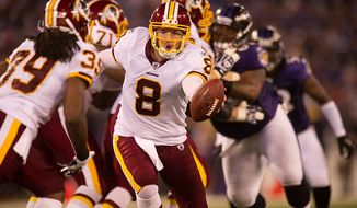 Quarterback Rex Grossman of the Washington Redskins hands off to Dante Barnes in preseason football at M&T Bank Stadium in Baltimore, MD, Thursday, August 25, 2011. (Andrew Harnik / The Washington Times)