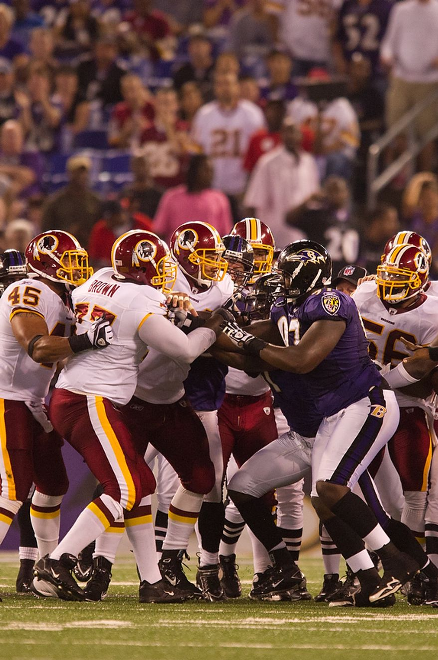 A fight between linemen breaks out after a play as the Washington Redskins take on the Baltimore Ravens in preseason football at M&T Bank Stadium in Baltimore, MD, Thursday, August 25, 2011. (Andrew Harnik / The Washington Times)
