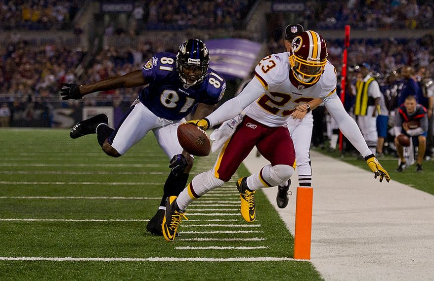 DeAngelo Hall of the Washington Redskins (23) is defended by Anquan Boldin of the Baltimore Ravens (81) as he scores a touchdown on an interception in the first quarter at M & T Bank Stadium in Baltimore, Md, Thursday, August 25, 2011. (Rod Lamkey Jr./The Washington Times)