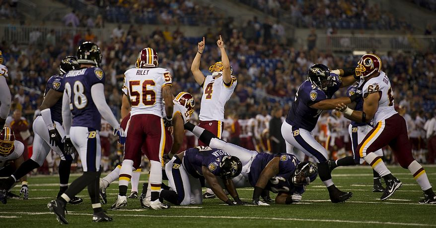 Graham Gano of the Washington Redskins (4) celebrates the extra point of DeAngelo Hall's touchdown against the Baltimore Ravens in the first quarter at M & T Bank Stadium in Baltimore, Md, Thursday, August 25, 2011. (Rod Lamkey Jr./The Washington Times)