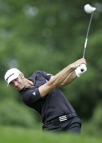 Dustin Johnson hits his tee shot on the 12th hole during the final round of The Barclays golf tournament Saturday, Aug. 27, 2011, in Ediso