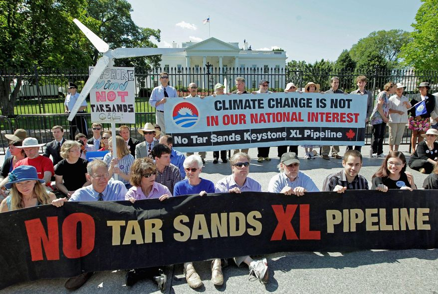 ** FILE ** Environmental activists gather outside the White House on Monday, Aug. 22, 2011, to protest the Keystone XL pipeline. (Associated Press)