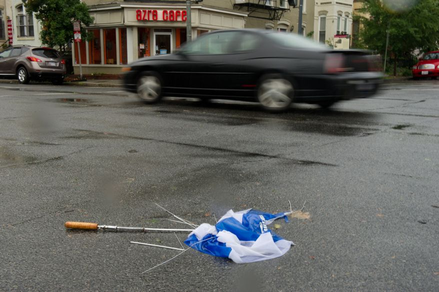 A destroyed umbrella lays in the street the morning after Hurricane Irene in Washington, DC, Sunday, August 28, 2011. (Andrew Harnik / The Washington Times)