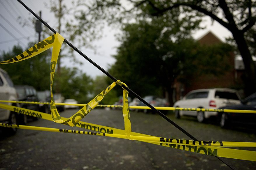 A line is down and taped off at the corner of Jefferson and S. Lee Streets in Old Town Alexandria, Va, Sunday, August 28, 2011. As Hurricane Irene makes her exit from the region and points northbound along the Atlantic coast, people start the process of cleaning up after the category one hurricane (Rod Lamkey Jr./The Washington Times)