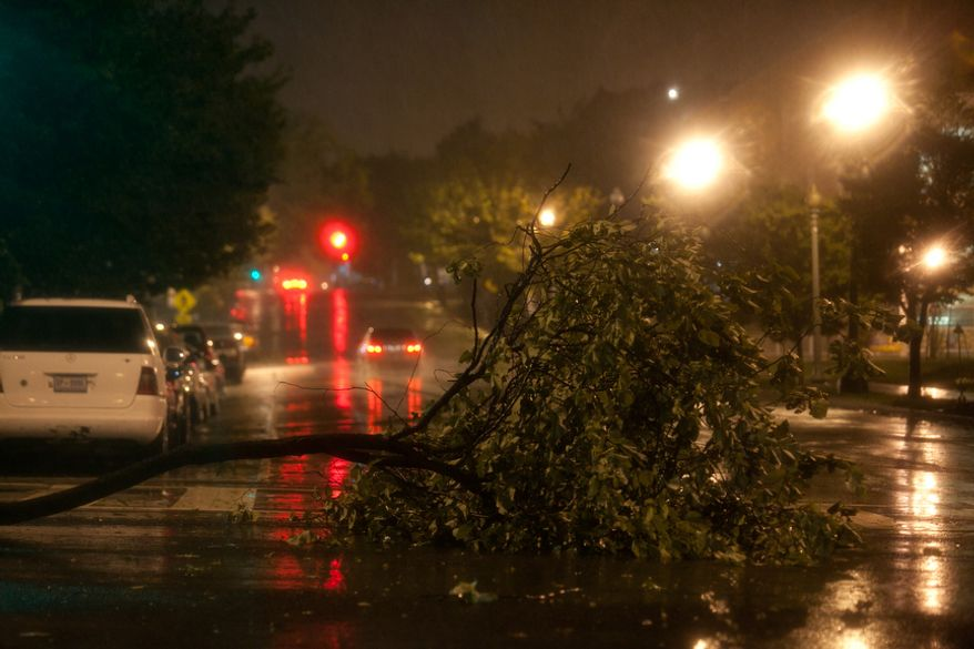 A downed tree limb lays across New Jersey Avenue and K St., NW in the early morning hours as Hurricane Irene passes through the Washington region in Washington, DC, Sunday, August 28, 2011. (Andrew Harnik / The Washington Times)