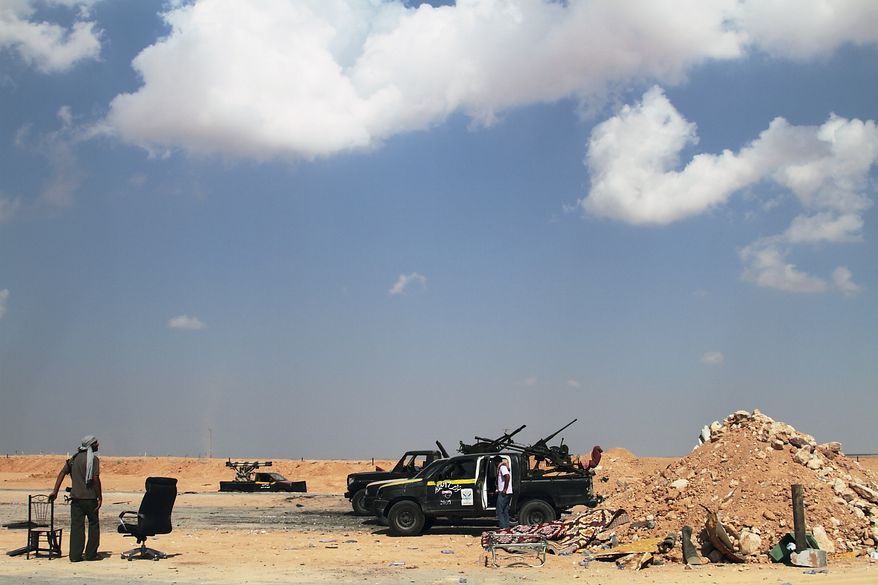Libyan rebels are seen on the road out of Misrata, Libya, 118 miles from Col. Moammar Gadhafi's hometown of Sirte, on Saturday, Aug. 27, 2011. (AP Photo/Gaia Anderson)