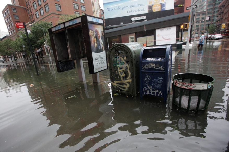 Grand Street and West Broadway in the Soho neighborhood of Manhattan is flooded, Sunday, Aug. 28, 2011 in New York.  (AP Photo/Mary Altaffer)
