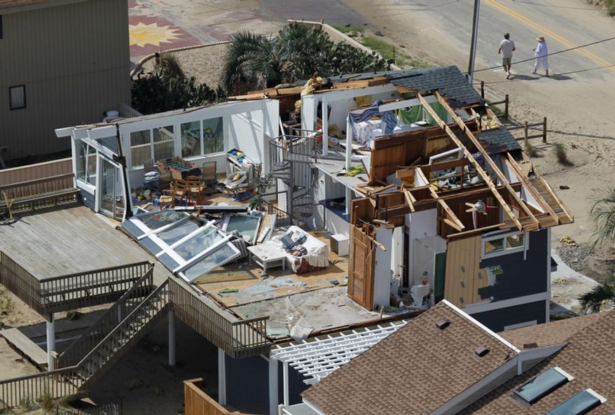 A house damaged by Hurricane Irene is seen in Virginia Beach, Va., Sunday, Aug. 28, 2011.   (AP Photo/Steve Helber)