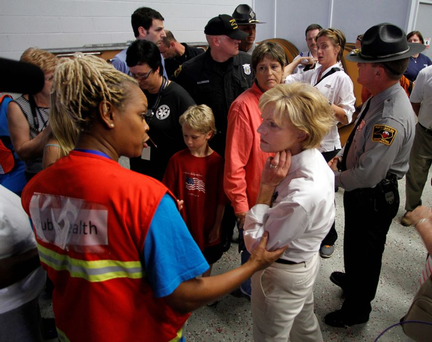 North Carolina Governor Bev Perdue, right, speaks with an Red Cross worker about damage Hurricane Irene left behind in Trenton, N.C., Sunday, Aug. 28, 2011. (AP Photo/Jim R. Bounds)