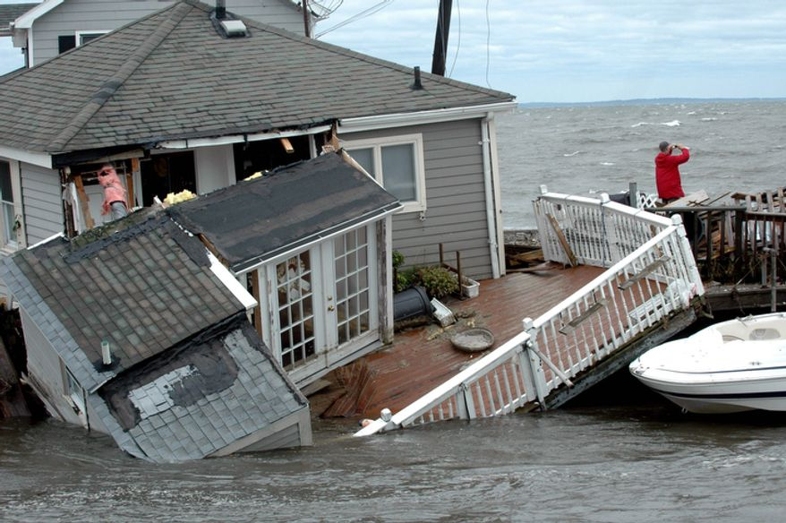 A Fairfield Beach Road home is submerged in Pine Creek in Fairfield, Conn. as treacherous weather caused by Tropical Storm Irene came through the area on Sunday Aug. 28, 2011.  (AP Photo/The Connecticut Post, Cathy Zuraw)
