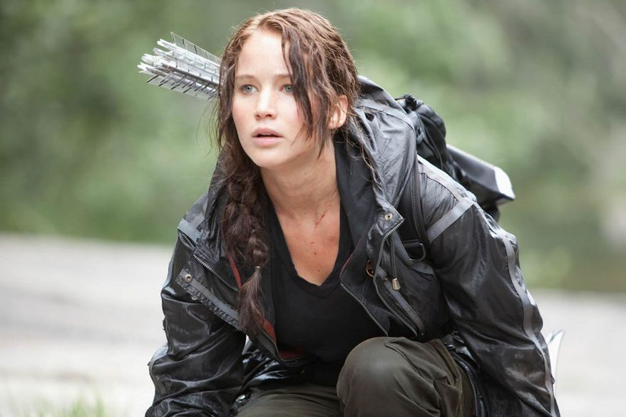 """PROVIDED BY LIONSGATE Oscar-nominated actress Jennifer Lawrence plays the protagonist, Katniss, in """"The Hunger Games."""" The first preview of the upcoming film, which takes place in a barbaric, dystopian future, debuted during Sunday's Video Music Awards ceremony."""