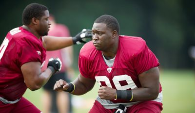 Washington Redskins defensive end Jarvis Jenkins (99) and defensive tackle Thomas Weaver (69) work through drills during training camp at Redskins Park in Ashburn, Va, Tuesday, August 9, 2011. (Rod Lamkey Jr./The Washington Times)