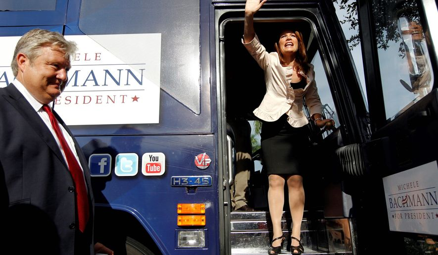 Rep. Michele Bachmann waves goodbye to a small group of supporters in the parking lot of Calistoga Bakery Cafe in Naples, Fla., on Monday after a brief campaign stop. (Naples (Fla.) Daily News via Associated Press)