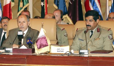 Mustafa Abdul-Jalil (left), head of the Libyan rebels' National Transitional Council, and Major Gen. Hamad bin Ali al-Attiyah, Qatari chief of staff, look on during NATO talks in Doha, Qatar, on Monday, Aug. 29, 2011. (AP Photo/Osama Faisal)