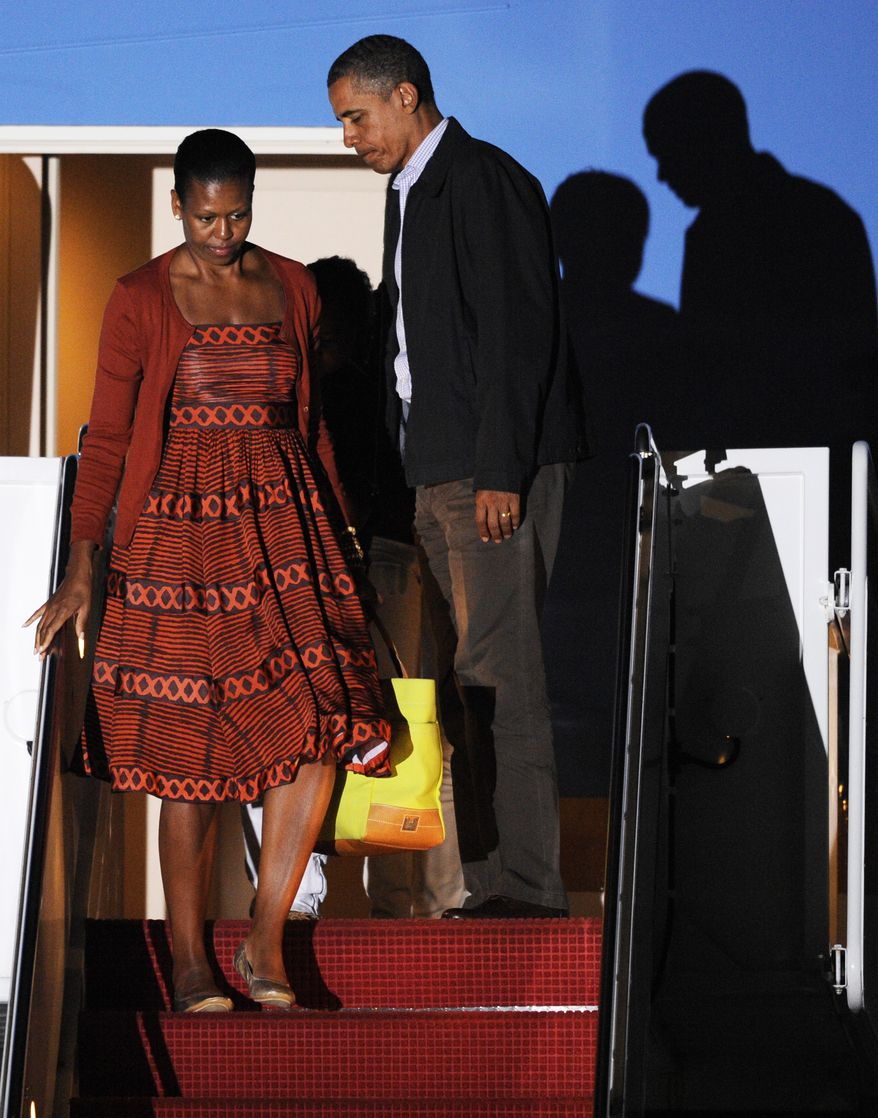 President Obama and first lady Michelle Obama exit Air Force One at Andrews Air Force Base, Md., on Aug. 26, 2011. (Associated Press)