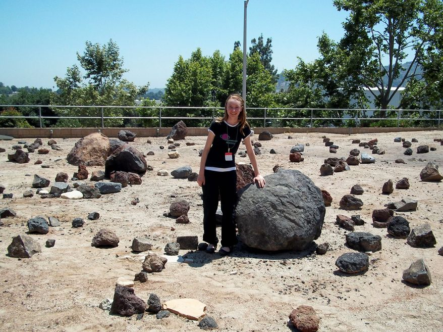 """ASSOCIATED PRESS Zoe Bentley, a 14-year-old """"unschooler,"""" visits the Mars Yard at NASA's Jet Propulsion Laboratory in Pasadena, Calif. Zoe's parents allow her to explore what she likes rather than take part in a traditional educational system."""