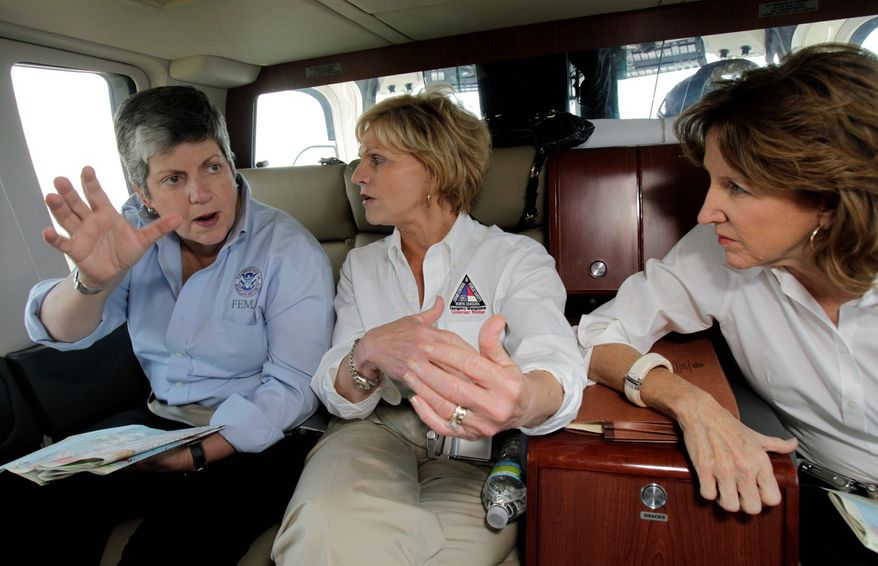 Homeland Security Secretary Janet Napolitano (left) takes a helicopter tour Tuesday of hurricane damage to North Carolina with Gov. Beverly Perdue (center) and Sen. Kay R. Hagan. Also Tuesday, she said she wants the National Guard to stay on the U.S.-Mexico border. (Associated Press)