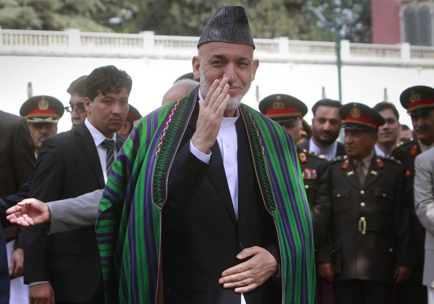 Afghan President Hamid Karzai is pictured after offering Eid al-Fitr prayers to mark the end of the holy fasting month of Ramadan in Kabul, Afghanistan, on Tuesday, Aug. 30, 2011. (AP Photo/Musadeq Sadeq)