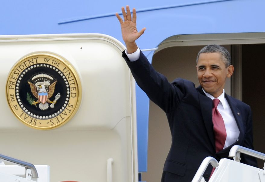 President Obama waves as he boards Air Force One at the Minneapolis St. Paul Airport in St. Paul, Minn., on Aug. 30, 2011, after addressing the American Legion in Minneapolis. (Associated Press)