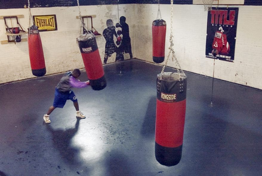 **FILE** Leandro Deleon, 16, a senior at Blair High School, works out Sept. 6, 2006, at Keely's District Boxing and Youth Center, an after-school program located in the basement of the Calvary United Methodist Church in D.C. The program was started by boxer Keely Thompson Jr. in 2004 as a way to keep kids off the streets. (The Washington Times)