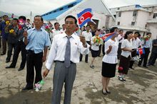 About 500 North Koreans gather to wave flags while revolutionary marches blared over loudspeakers to send off the Mangyongbong. (Associated Press)