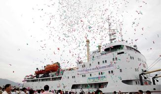The North Korean leisure boat Mangyongbong is sent off on its first trial cruise Tuesday from the port city of Rason to the Mount Kumgang resort. The maiden voyage carried dozens of Chinese travel agents, international media and North Korean officials. (Associated Press)