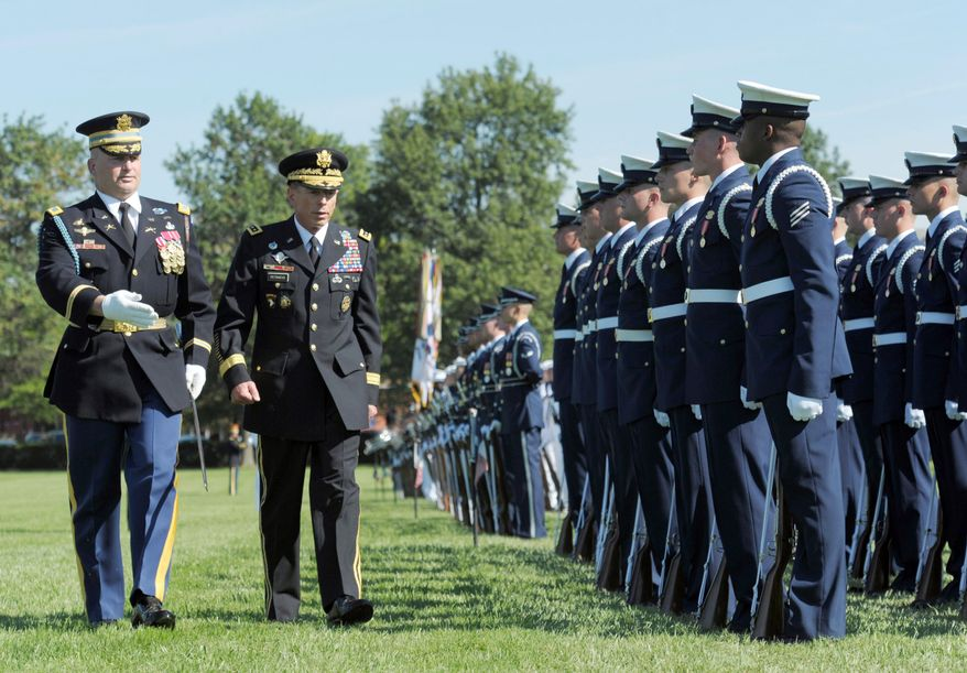 ASSOCIATED PRESS Former Commander of International Security Assistance Force and U.S. Forces-Afghanistan Gen. David H. Petraeus (second from left) reviews the troops during a farewell tribute and retirement ceremony at Joint Base Myer-Henderson Hall in Arlington.