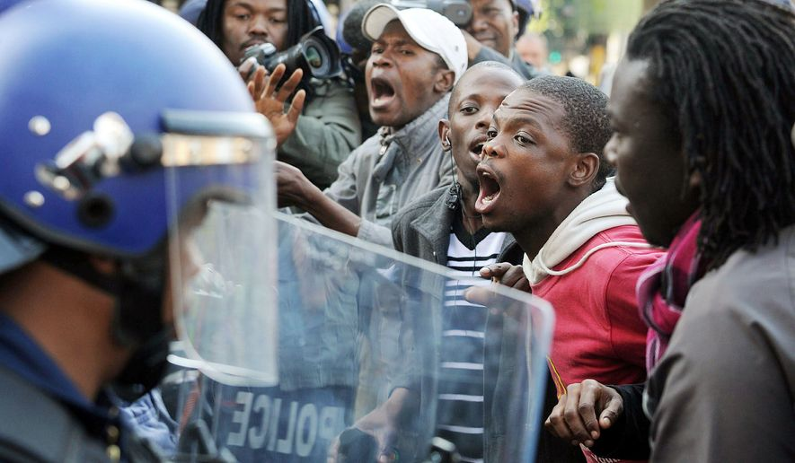 Mr. Malema's supporters, some of whom pelted police and reporters with stones and bottles, confront police on Tuesday. Mr. Malema's calls for radical changes have mobilized unemployed and disillusioned youths. (Associated Press)