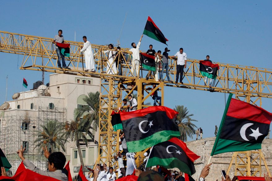Libyans gather in Martyrs' Square, formerly Green Square, for the morning Eid prayer to mark the end of Ramadan and to celebrate their victory over embattled Col. Moammar Gadhafi in Tripoli, Libya, on Wednesday, Aug. 31, 2011. (AP Photo/Francois Mori)
