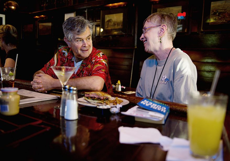 """BARBARA L. SALISBURY / THE WASHINGTON TIMES Phil Panitch and Betty Auman chat over lunch at the Hawk 'n' Dove bar on Capitol Hill on Wednesday, the day its closing was announced. Mr. Panitch, who has been coming to the bar since 1976, said he was """"shocked"""" to hear the news. Ms. Auman, who eats lunch here three out of five days of the workweek, said, """"I couldn't believe it. I mean, it's an institution, and it's my lunchtime home with family that I regularly see."""""""