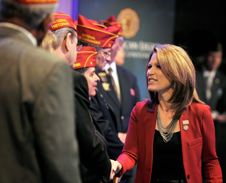 "ASSOCIATED PRESS Republican presidential candidate Michele Bachmann greets American Legion officers Thursday after addressing their national convention in Minneapolis. She said she would be a ""strong leader."""