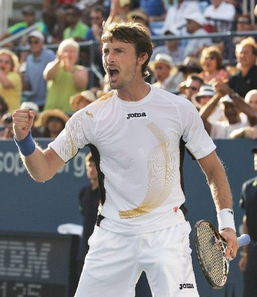 ASSOCIATED PRESS Juan Carlos Ferrero exults after defeating No. 7 seed Gael Monfils in a five-set, second-round match that lasted nearly five hours.