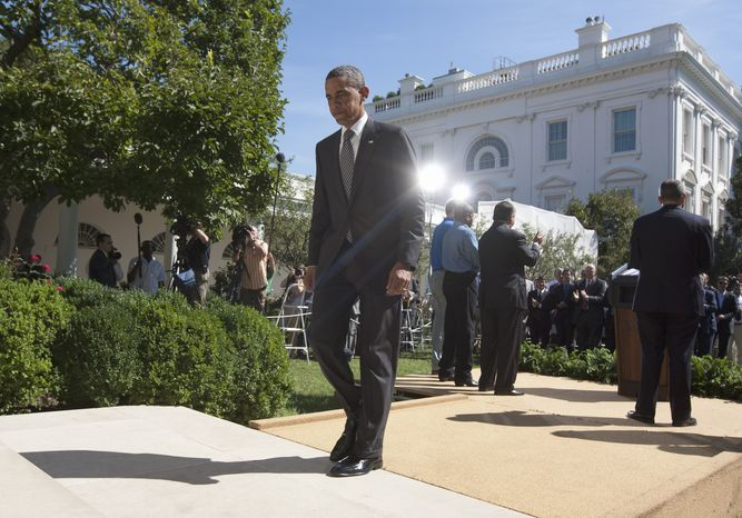 President Obama walks from the podium after speaking Aug. 31, 2011, at the White House to urge Congress to pass a federal highway bill. (Associated Press)