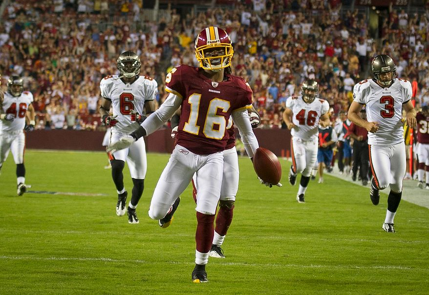 Washington Redskins wide receiver Brandon Banks (16) drops the ball while celebrating his 95 yard kick off return touchdown against the Tampa Bay Buccaneers in the second quarter at FedEx Field in Landover, Md., Thursday, September 1, 2011, in the last pre-season game. (Rod Lamkey Jr./The Washington Times)