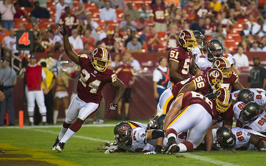 DeJon Gomes (24) of the Washington Redskins celebrates the defense stopping the Tampa Bay Buccaneers in scoring position, on a fourth down in the first quarter at FedEx Field in Landover, Md., Thursday, September 1, 2011, in the last pre-season game. (Rod Lamkey Jr./The Washington Times)