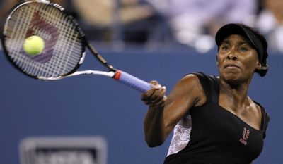 Venus Williams, of the United States, returns against Vesna Dolonts, of Russia, during the first round of the U.S. Open tennis tournament in New York, Monday, Aug. 29, 2011. (AP Photo/Charles Krupa)