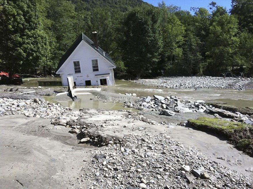 A home in Pittsfield, Vt., is partially submerged after floodwaters from Hurricane Irene ravaged the state in 2011. (Associated Press)