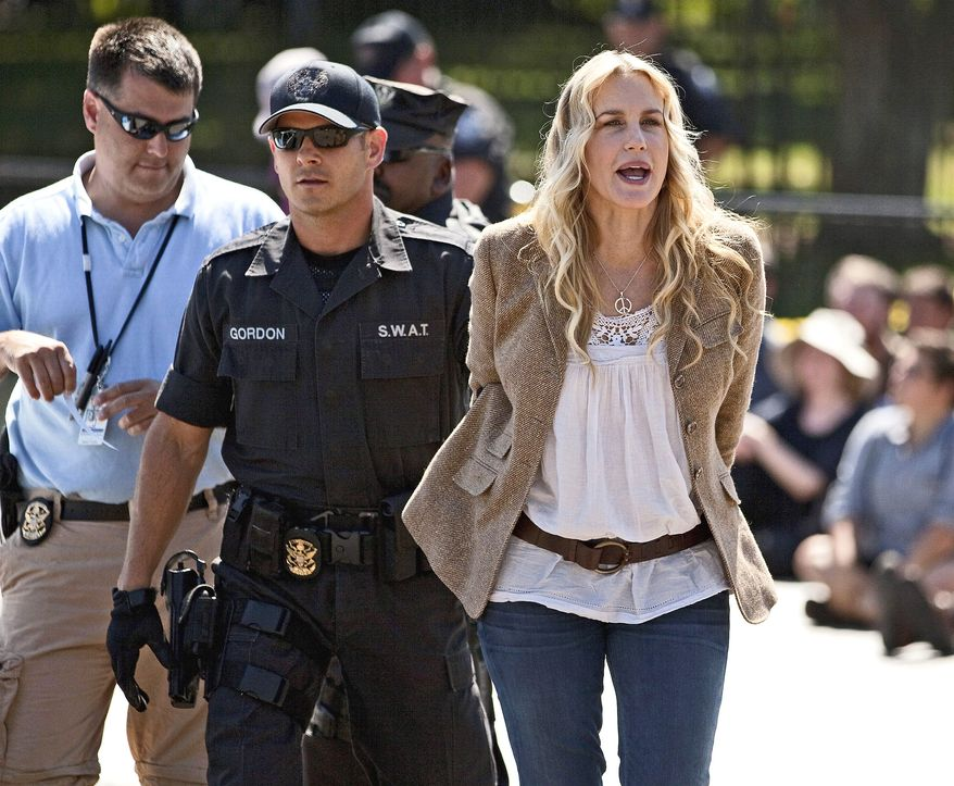 Actress Daryl Hannah is arrested Tuesday by U.S. Park Police near the White House during a protest against the proposed Keystone XL multistate oil pipeline. The pipeline would have a minimal environmental impact, the administration says. (Associated Press)