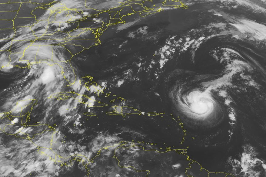 This NOAA satellite image taken on Saturday, Sept. 4, 2011, at 2 a.m. EDT shows Tropical Storm Katia, which increased to hurricane strength on Sunday, at center right. Tropical Storm Lee is seen off the U.S. Gulf Coast at center left in the photo. (AP Photo/Weather Underground)