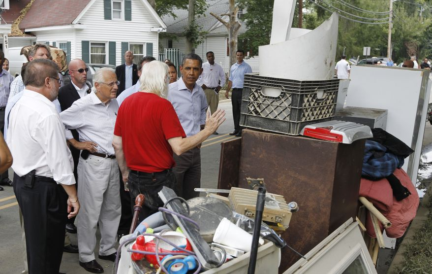 President Obama talks with residents of Fayette Avenue in Wayne, N.J., on Sunday, Sept. 4, 2011, as he visits Garden State areas flooded by Hurricane Irene. (AP Photo/Charles Dharapak)