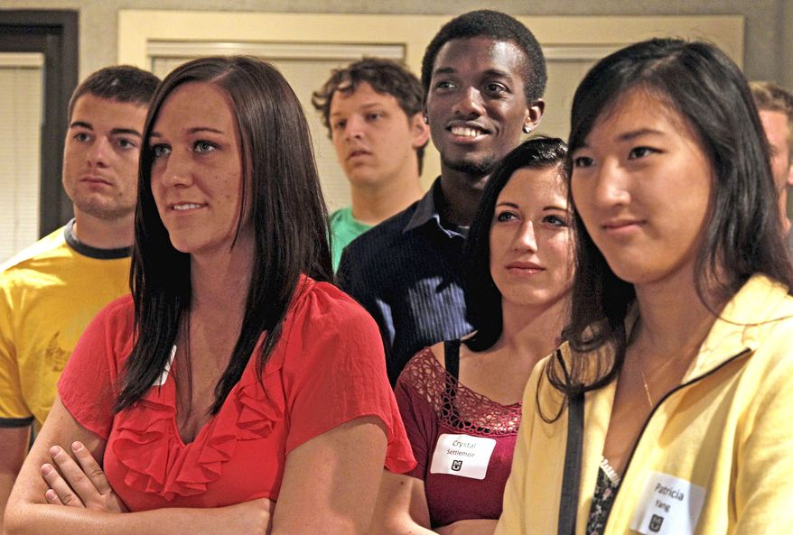 First-year law students from the University of Missouri participate in a community service project at a food bank in Columbia, Mo., in August. After several years of recession-driven enrollment gains, application to law schools nationwide are down nearly 10 percent this year. (Associated Press)