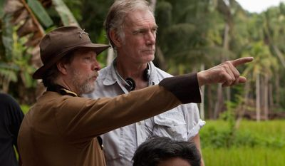"Variance Films Actor Chris Cooper (left), a regular in director John Sayles' movies, confers with Mr. Sayles during the filming of ""Amigo."""