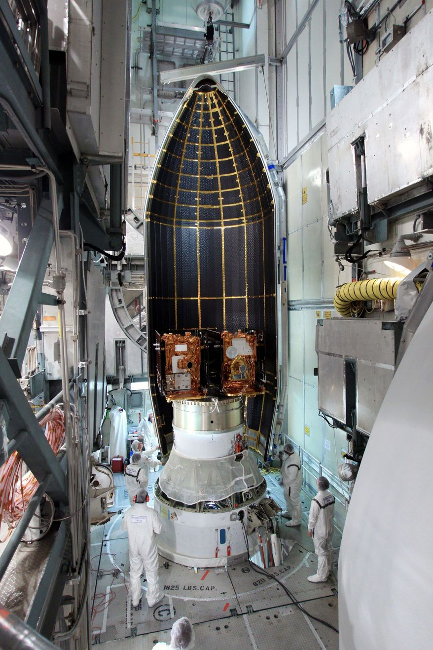 NASA VIA ASSOCIATED PRESS Technicians work on the GRAIL booster at the Kennedy Space Center in Cape Canaveral, Fla., on Aug. 25. It is scheduled to launch on Thursday.