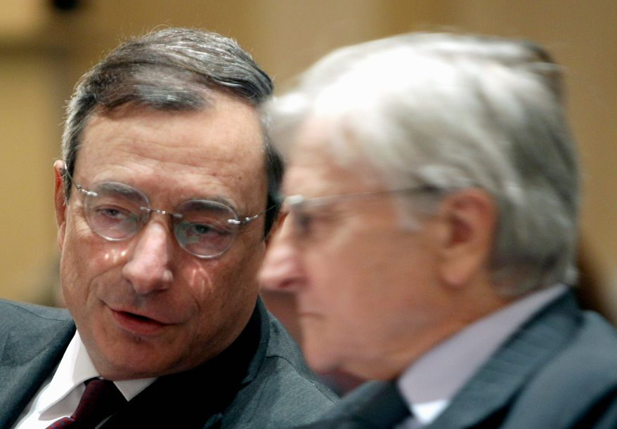 """European Central Bank head Jean-Claude Trichet (right) listens to Mario Draghi, next to take the helm of the bank, during a conference on the European debt crisis on Monday in Paris. Mr. Draghi called for a """"quantum"""" leap toward economic integration. (Associated Press)"""