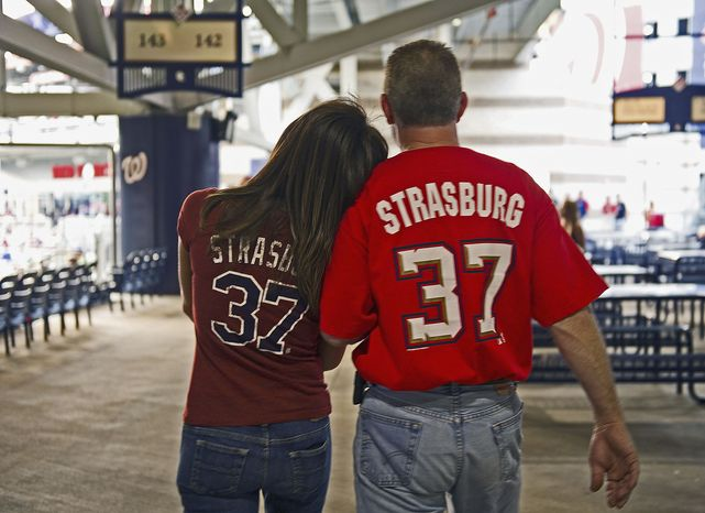 Photographs by Barbara L. Salisbury/The Washington Times Tammy Hill of Woodbridge, Va., and Roger Harris of Catlett, Va., sport Washington Nationals jerseys bearing the name of pitcher Stephen Strasburg at Nationals Stadium on Friday. Strasburg returns to the majors Tuesday after elbow sur
